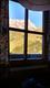 Blick aus der Wirtsstube auf den <em>Weißgrubenkopf</em> in der Abendsonne